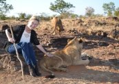 Hanging out with two 14-month-old lion cubs at African Encounter Lion Rehabilitation.