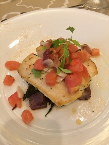 Pan-seared halibut with tomato-olive relish, wilted spinach and purple potatoes.