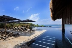 The infinity pool appears to merge into the Caribbean Sea at Nizuc Resort & Spa, Cancun.