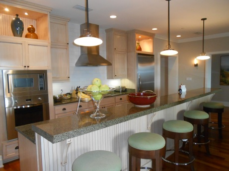 The great space includes a gourmet kitchen, formal dining center and comfortable lounging area.