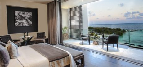 Ocean Suite with glass-wrapped balcony at Nizuc Resort & Spa, Cancun.
