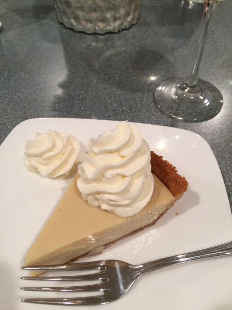 Key lime pie with fresh whipped cream and lime swirl