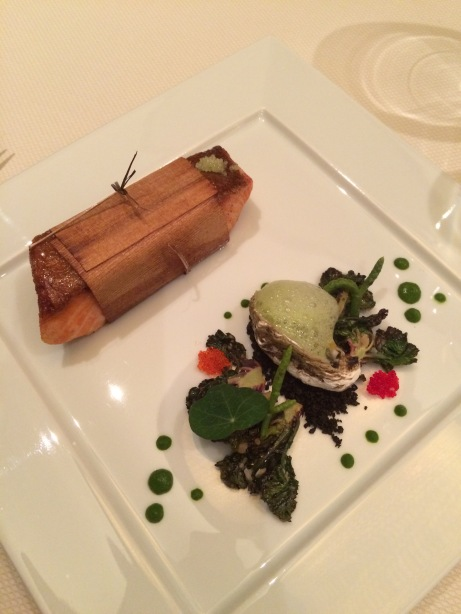 Cedar wrapped sea trout with Kumamoto oyster, agave fingerlime, black sand, kalettes, cactus escabeche