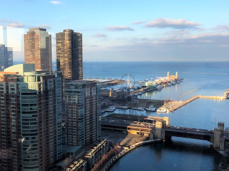 Urban view of Chicago River, Lake Michigan and Navy Pier with Ferris Wheel, from 40th story window of skyscaper hotel.