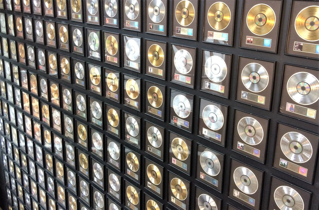 A wall filled with framed gold and platinum records at the Country Music Hall of Fame and Museum.